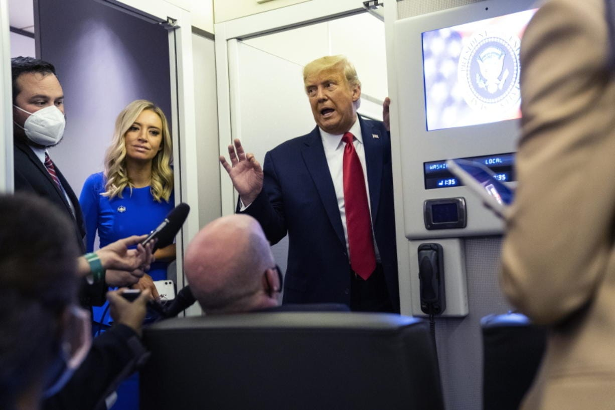 President Donald Trump talks with reporters on Air Force One after participating in the final presidential debate, Thursday, Oct. 22, 2020, in Nashville, Tenn.