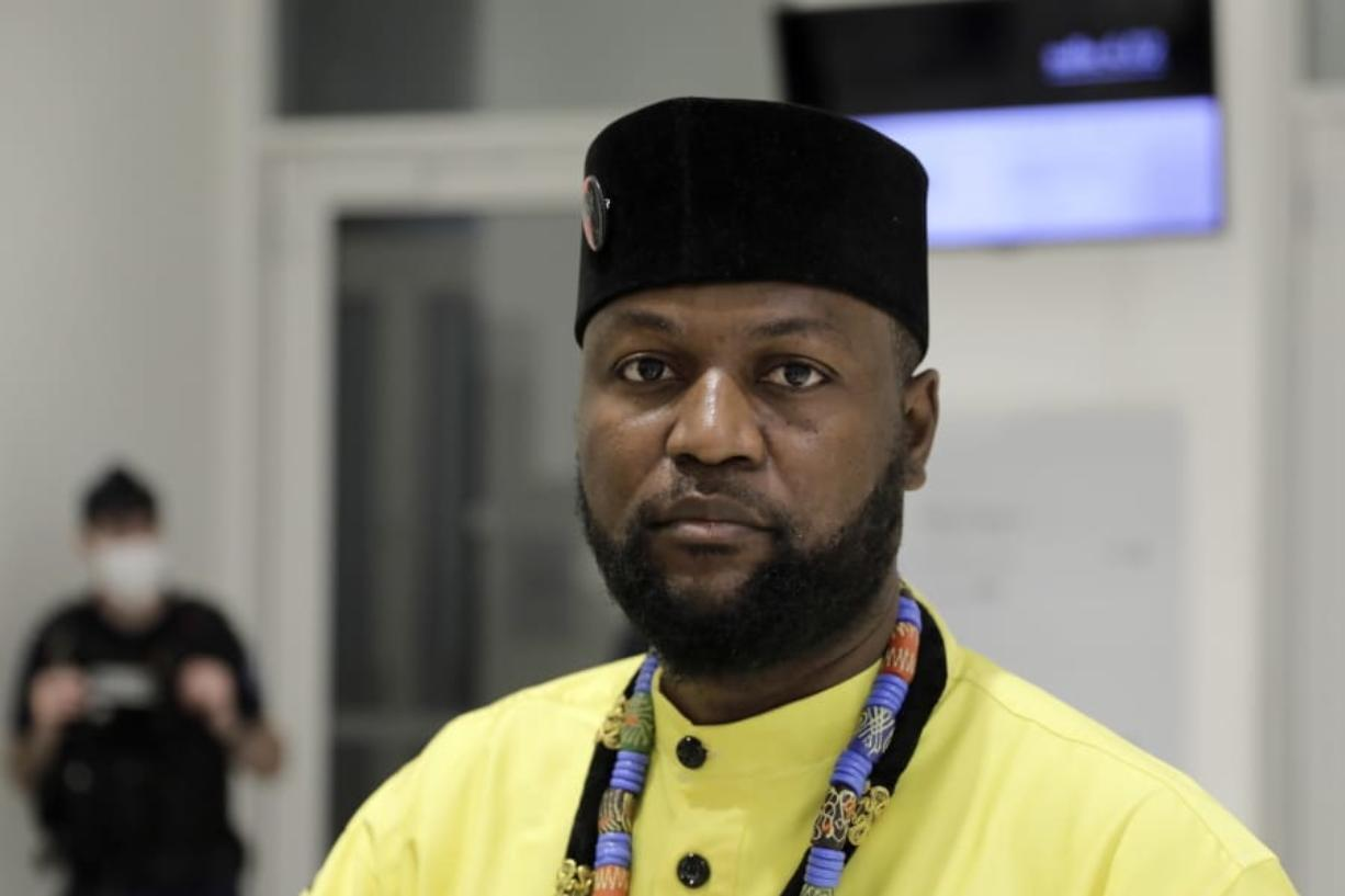 Congo-born Emery Mwazulu Diyabanza looks on after the verdict at the Paris Palace of Justice, Wednesday, Oct. 14, 2020. Diyabanza was fined 2,000 euros ($2,320) for trying to take a 19th-century African funeral pole from a Paris museum. He streamed the incident online in a protest against colonial-era injustice like the plundering of African art.