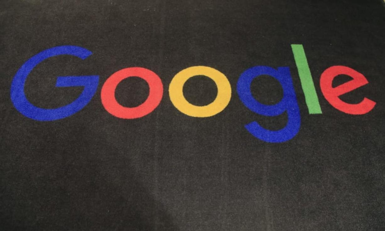 FILE - In this Monday, Nov. 18, 2019, file photo, the logo of Google is displayed on a carpet at the entrance hall of Google France in Paris. The Trump administration's legal assault on Google actually feels like a blast from the past.