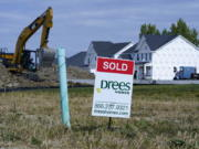 """A """"sold"""" sign sits on a lot as new home construction continues in Westfield, Ind., Friday, Sept. 25, 2020. U.S. home construction rose a solid 1.9% in September after having fallen in August as home building remains one of the bright spots for the economy."""