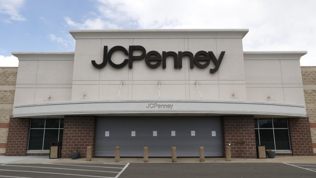 FILE - In this May 8, 2020 file photo, a parking lot at a JC Penney store is empty in Roseville, Mich.  J.C. Penney anticipates being out of bankruptcy protection before the December holiday season. The retailer said Wednesday, Oct. 21 that it filed a draft asset purchase agreement under which mall owners Brookfield Asset Management Inc. and Simon Property Group will acquire substantially all of its retail and operating assets through a combination of cash and new term loan debt.