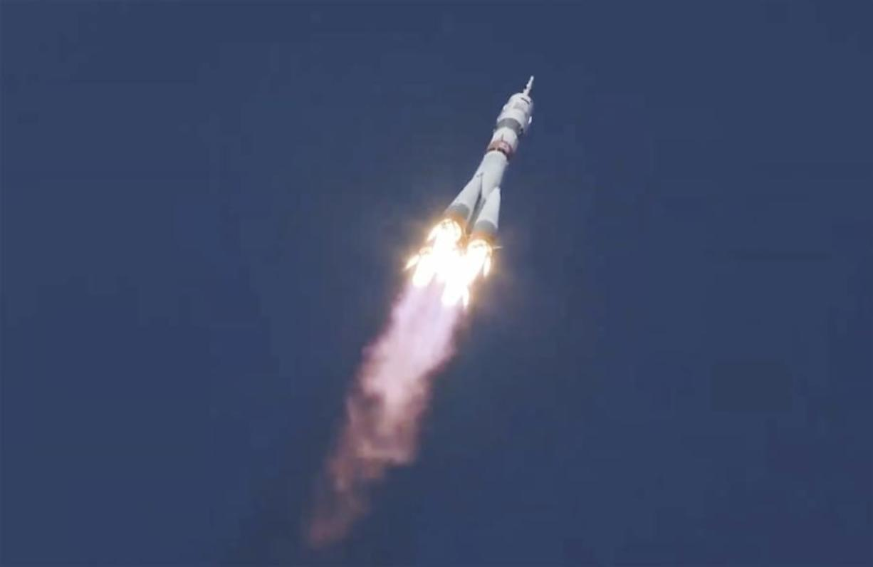 In this image made from video footage released by Roscosmos Space Agency, the Soyuz-2.1a rocket booster with the Soyuz MS-17 space ship carrying a new crew to the International Space Station (ISS), blasts off at the Russian leased Baikonur cosmodrome, Kazakhstan, Wednesday, Oct. 14, 2020. A trio of space travelers has launched successfully to the International Spce Station, for the first time using a fast-track maneuver to reach the orbiting outpost in just three hours. NASA's Kate Rubins and Sergey Ryzhikov and Sergey Kud-Sverchkov of the Russian space agency Roscosmos lifted off as scheduled at 10:45 a.m. (1:45 a.m. EDT, 5:45 a.m. GMT) Wednesday from the Russia-leased Baikonur space launch facility in Kazakhstan for a six-month stint on the station.