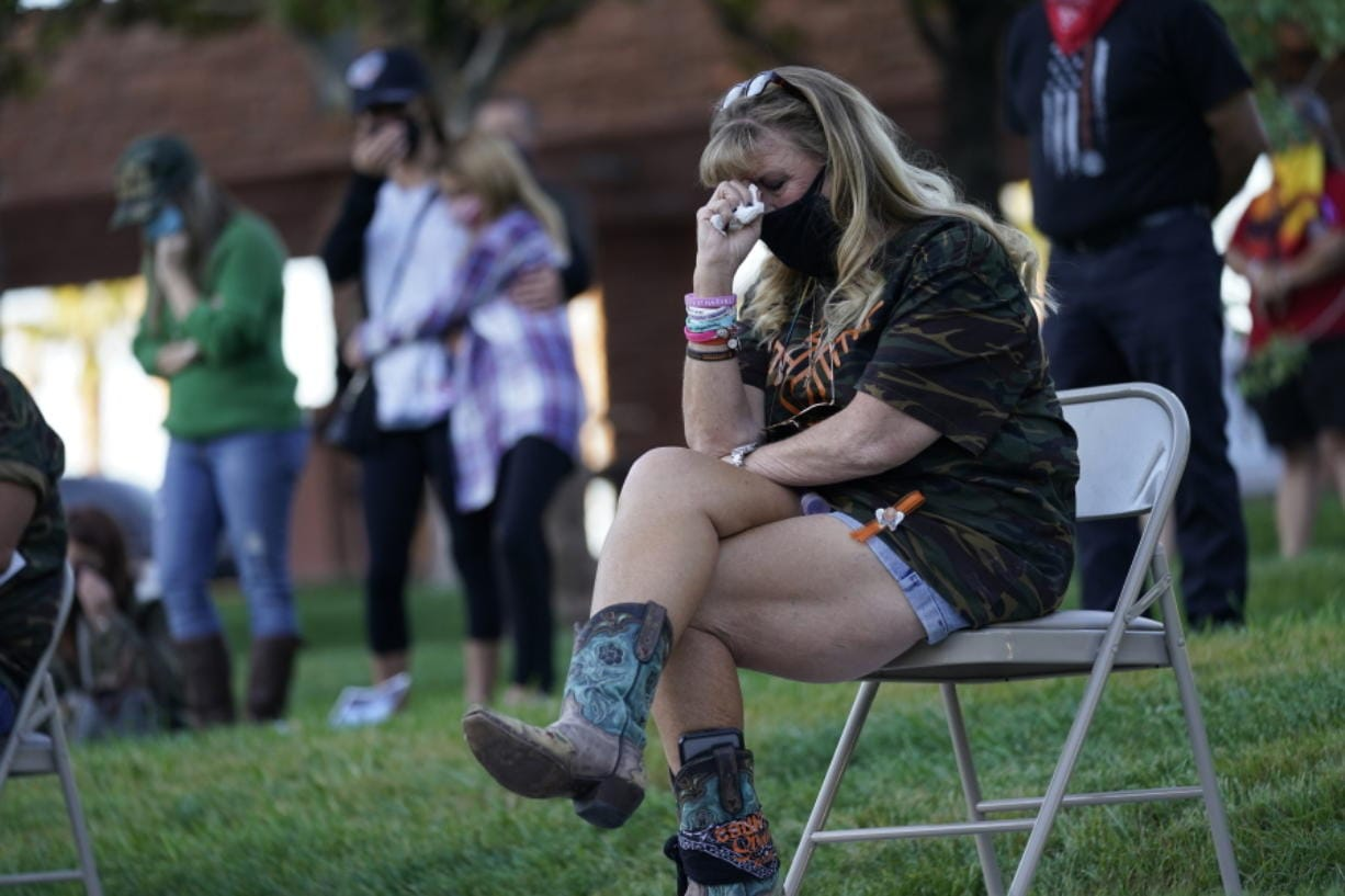 An unidentified woman cries during a ceremony Thursday, Oct. 1, 2020, on the anniversary of the mass shooting three years earlier in Las Vegas. The ceremony was held for survivors and victim's families of the deadliest mass shooting in modern U.S. history.