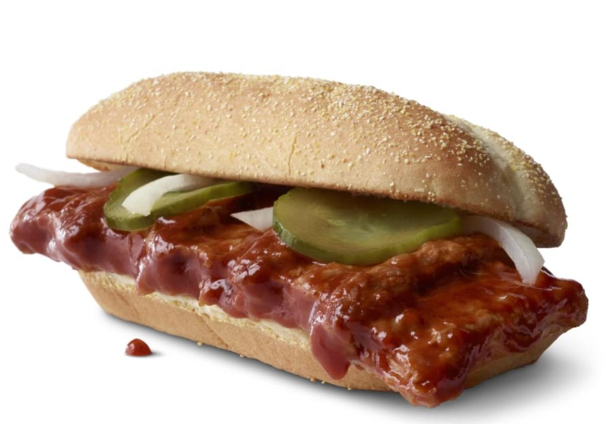 This photo provided by McDonald's shows the McRib sandwich.  McDonald's announced that it was bringing its barbeque slathered sandwich with the cult following back for yet another run on Dec. 2. The fast-food giant said the sandwich would be available nationally for the first time since 2012, but only at participating restaurants for a limited time.