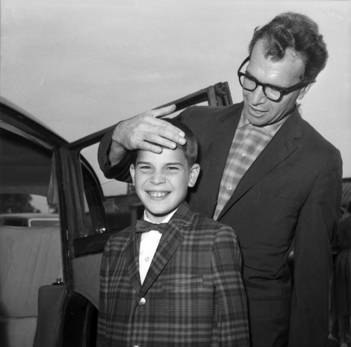 "FILE - In this July 2, 1961, file photo, Dave Brubeck, the American Jazz musician, and his 13-year-old son Christopher, also a musician, arrive at London Airport, United Kingdom, from New York. Nearly eight years after his death, the final solo recording of late American jazz legend Dave Brubeck is set for release Nov. 6, 2020. Verve Records announced that ""Lullabies,"" a collection of intimate standards often played for children, will be available in the latest effort by a label to preserve unreleased jazz recordings."