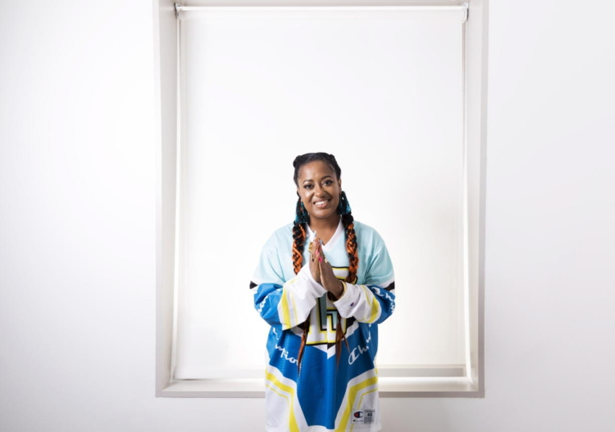 "FILE - This Aug. 22, 2019 photo shows Rapsody posing for a portrait in New York. Rapsody's ""Pray Momma Don't Cry"" is one of four songs featured on ""I Can't Breath/Music for the Movement,"" a four-song album that is a joint venture between Disney Music Group and The Undefeated, ESPN's platform for exploring the intersections of race, sports and culture. Rapsody is hoping the album can unite people."