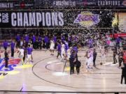 The Los Angeles Lakers players celebrate after the Lakers defeated the Miami Heat 106-93 in Game 6 of basketball's NBA Finals Sunday, Oct. 11, 2020, in Lake Buena Vista, Fla. (AP Photo/Mark J.