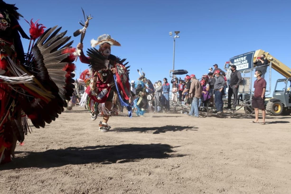 Native American dancers perform at a Donald Trump rally Oct. 15, 2020 at the rodeo grounds in Williams, Arizona. Navajo Nation President Myron Lizer makes no qualms about it: As one of the top officials on the country's largest Native American reservation, he's a proud Donald Trump supporter. Lizer says Native American values - hard work, family and ranching - align more with the GOP than with Democrats.