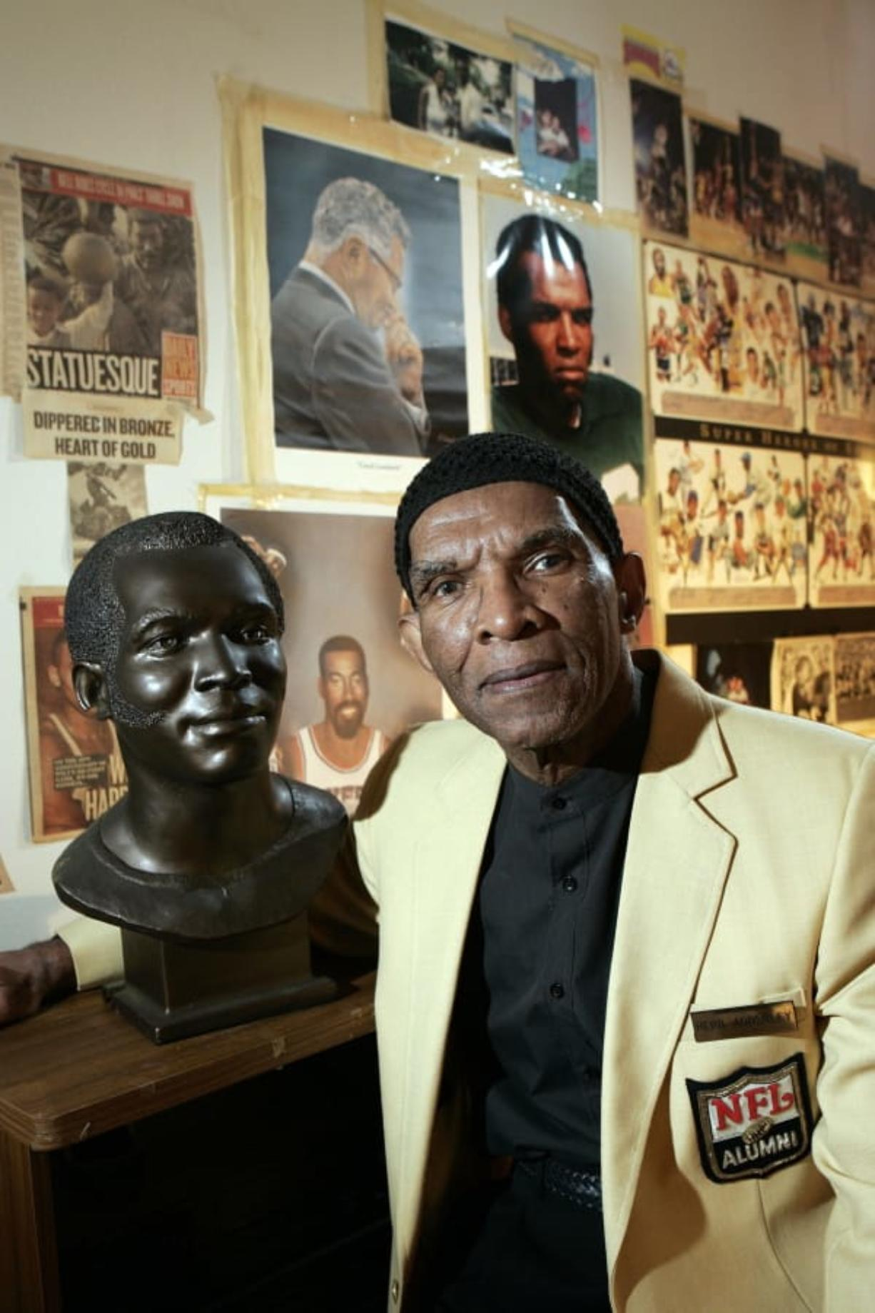 Former NFL player Herb Adderley poses next to a copy of his Hall of Fame bust in a room full of memorabilia from his playing days on Oct. 2, 2008, at his home in Mantua, N.J. The Hall of Fame cornerback has died at age 81. His death was confirmed Friday, Oct. 30, 2020, on Twitter by nephew Nasir Adderley, a safety for the Los Angeles Chargers. Adderley played on six NFL title teams over a 12-year career with Green Bay and Dallas.