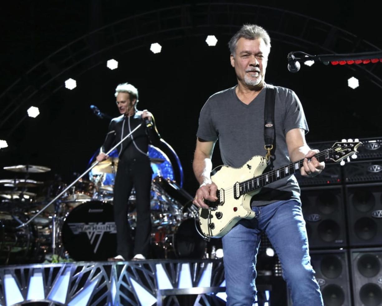 FILE - David Lee Roth, left, and Eddie Van Halen of Van Halen perform on Aug. 13, 2015, in Wantagh, N.Y. Van Halen, who had battled cancer, died Tuesday, Oct. 6, 2020. He was 65.