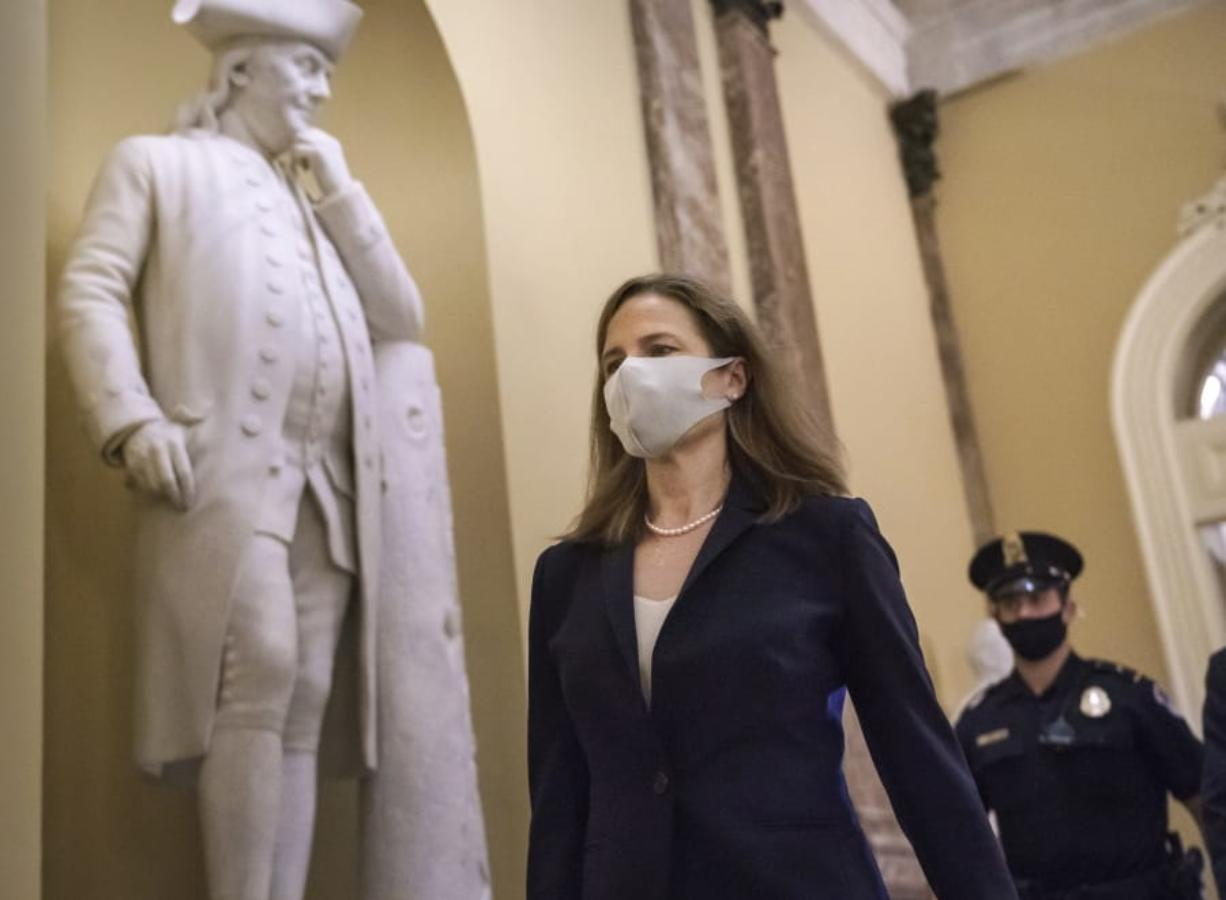 Judge Amy Coney Barrett, President Donald Trump's nominee for the Supreme Court, arrives for closed meetings with senators, at the Capitol in Washington, Wednesday, Oct. 21, 2020. (AP Photo/J.