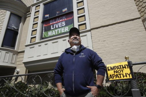 """FILE - In this June 14, 2020, file photo, James Juanillo poses outside of his home in San Francisco. Fed up with white people calling 911 about people of color selling water bottles, barbecuing or otherwise going about with life, San Francisco Board of Supervisors will vote Tuesday, Oct. 20, 2020, on the Caution Against Racial and Exploitative Non-Emergencies Act, also known as the CAREN legislation, a nod to a widespread meme using the name """"Karen"""" to describe a specific type of white, middle-aged woman, who exhibits behaviors that stem from privilege such as using the police to target people of color."""