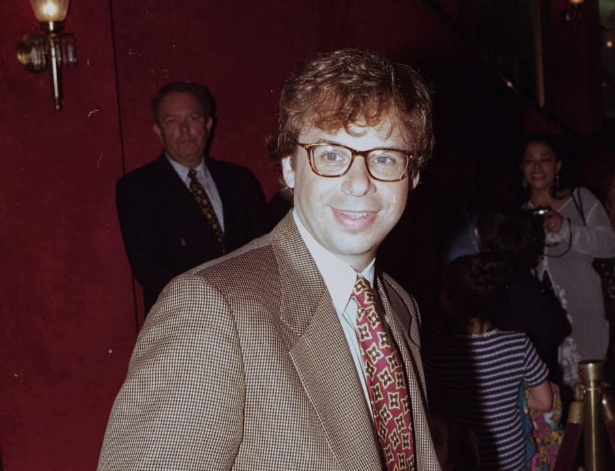 FILE - In this May 1994 file photo, actor Rick Moranis is shown at an unknown location.  A law enforcement official tells the Associated Press that Moranis was sucker punched by an unknown assailant while walking Thursday, Oct. 1, 2020, on a sidewalk near New York's Central Park.   Moranis took himself to the hospital and later went to a police station to report the incident, according to the official, who was not authorized to speak publicly about the incident and did so on condition of anonymity.