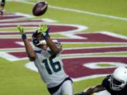 Seattle Seahawks wide receiver Tyler Lockett (16) pulls in a touchdown pass as Arizona Cardinals cornerback Dre Kirkpatrick (20) defends during the second half of an NFL football game, Sunday, Oct. 25, 2020, in Glendale, Ariz. (AP Photo/Ross D.