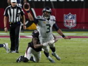 Seattle Seahawks quarterback Russell Wilson (3) gets the throw off as Arizona Cardinals linebacker Kylie Fitts makes the hit during the second half of an NFL football game, Sunday, Oct. 25, 2020, in Glendale, Ariz. (AP Photo/Rick Scuteri) (Associated Press/Ross D.
