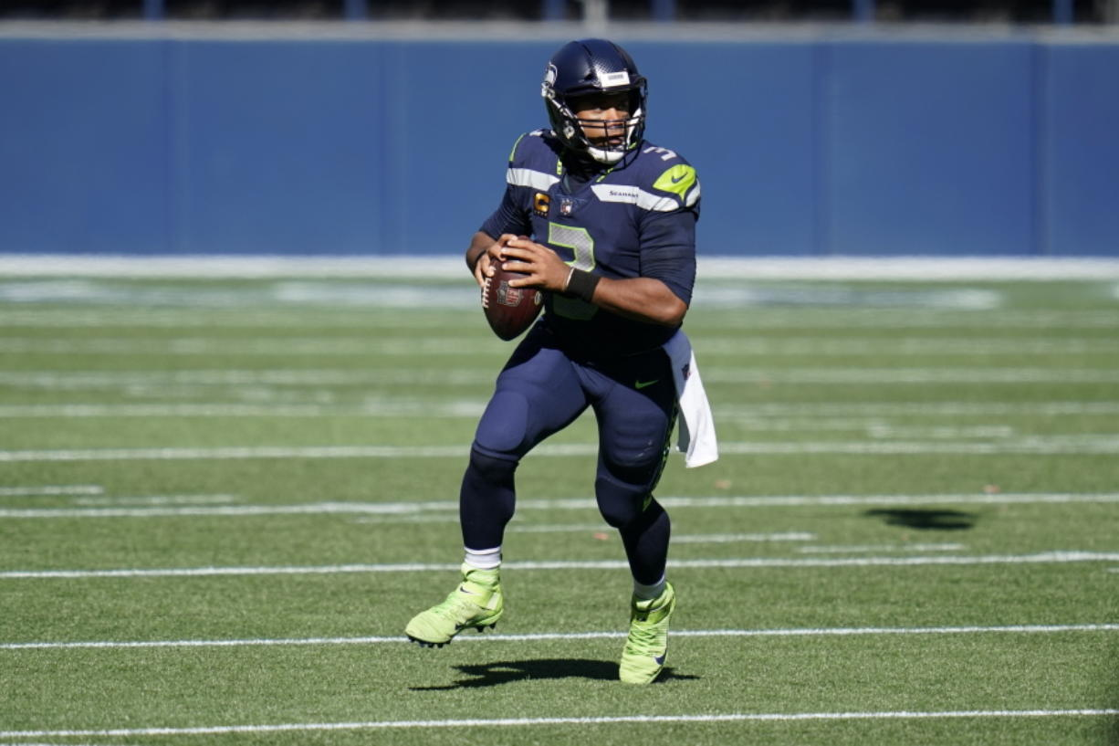 Seattle Seahawks quarterback Russell Wilson leads the NFL with 14 touchdown passes. The Seahawks play at the Miami Dolphins on Sunday, Oct. 4, 2020.