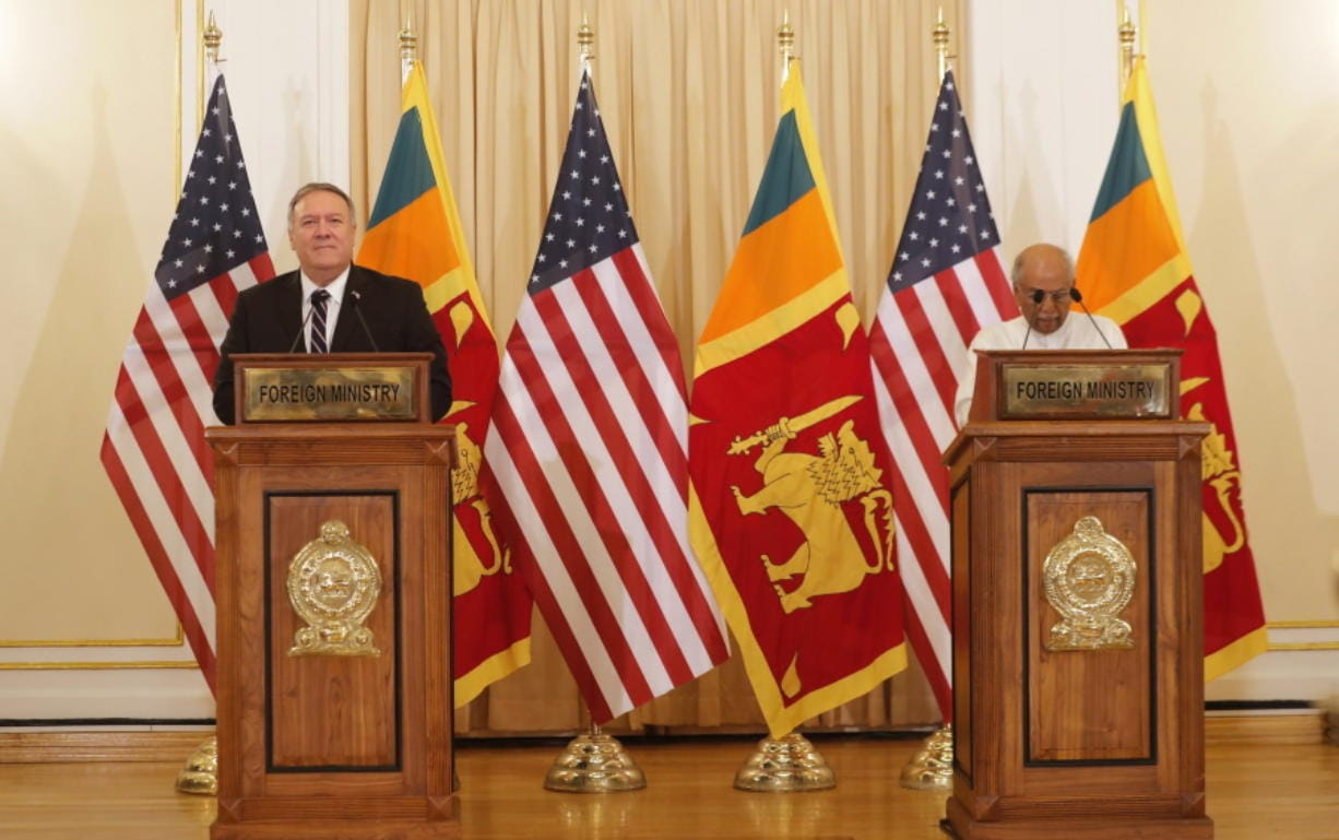 U.S. Secretary of State Mike Pompeo and Sri Lankan Foreign Minister Dinesh Gunawardena attend a joint press briefing in Colombo, Sri Lanka, Wednesday, Oct. 28, 2020. Pompeo plans to press Sri Lanka to push back against Chinese assertiveness, which U.S. officials complain is highlighted by predatory lending and development projects that benefit China more than the presumed recipients. The Chinese Embassy in Sri Lanka denounced Pompeo's visit to the island even before he arrived there, denouncing a senior U.S. official's warning that the country should be wary of Chinese investment.