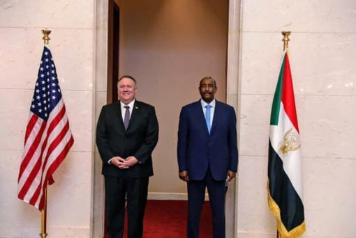 FILE - In this Aug. 25, 2020 file photo, U.S. Secretary of State Mike Pompeo stands with Sudanese Gen. Abdel-Fattah Burhan, the head of the ruling sovereign council, in Khartoum, Sudan. Officials in Sudan confirmed that a senior U.S.-Israeli delegation flew to Sudan on a private jet Wednesday, Oct. 21, 2020, and met with Burhan and others to wrap up a deal that would make Sudan the third Arab country to normalize ties with Israel this year.