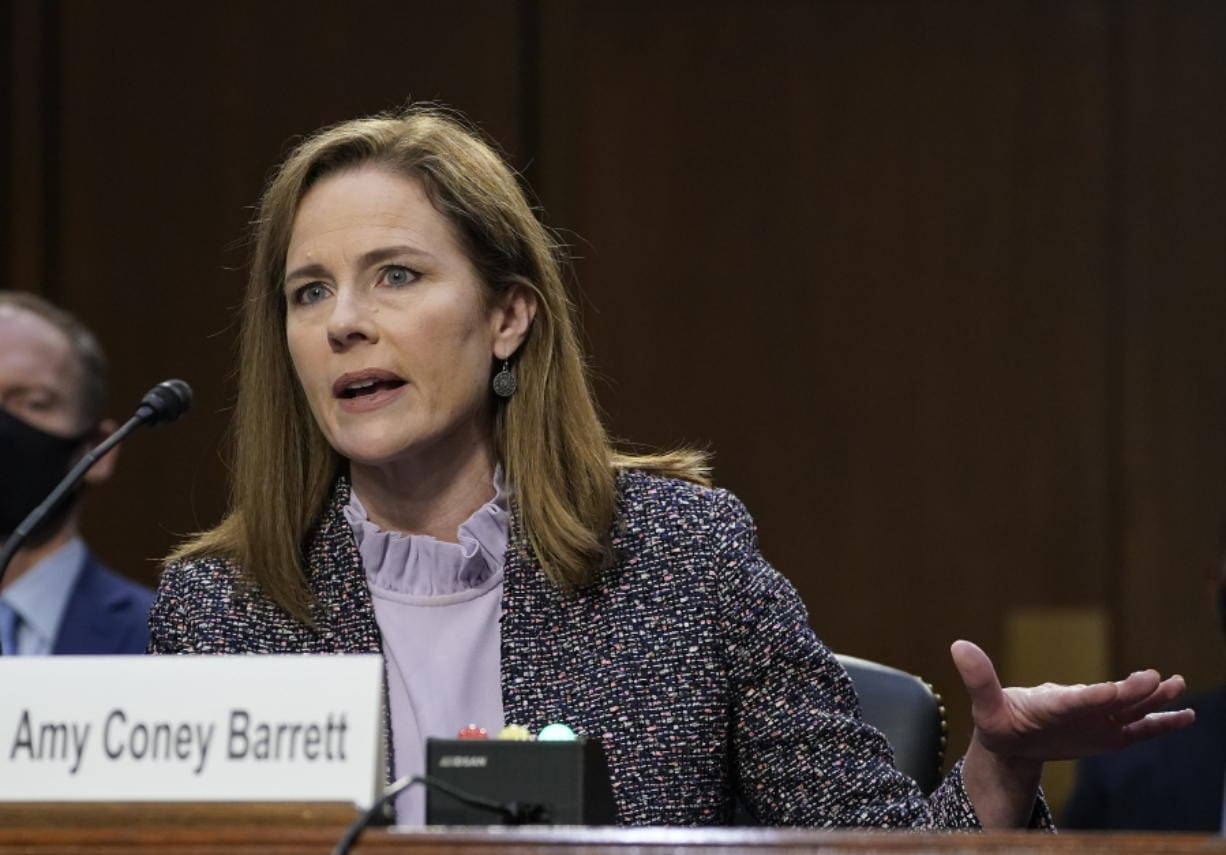 Supreme Court nominee Amy Coney Barrett testifies before the Senate Judiciary Committee during the third day of her confirmation hearings on Capitol Hill in Washington, Wednesday, Oct. 14, 2020.