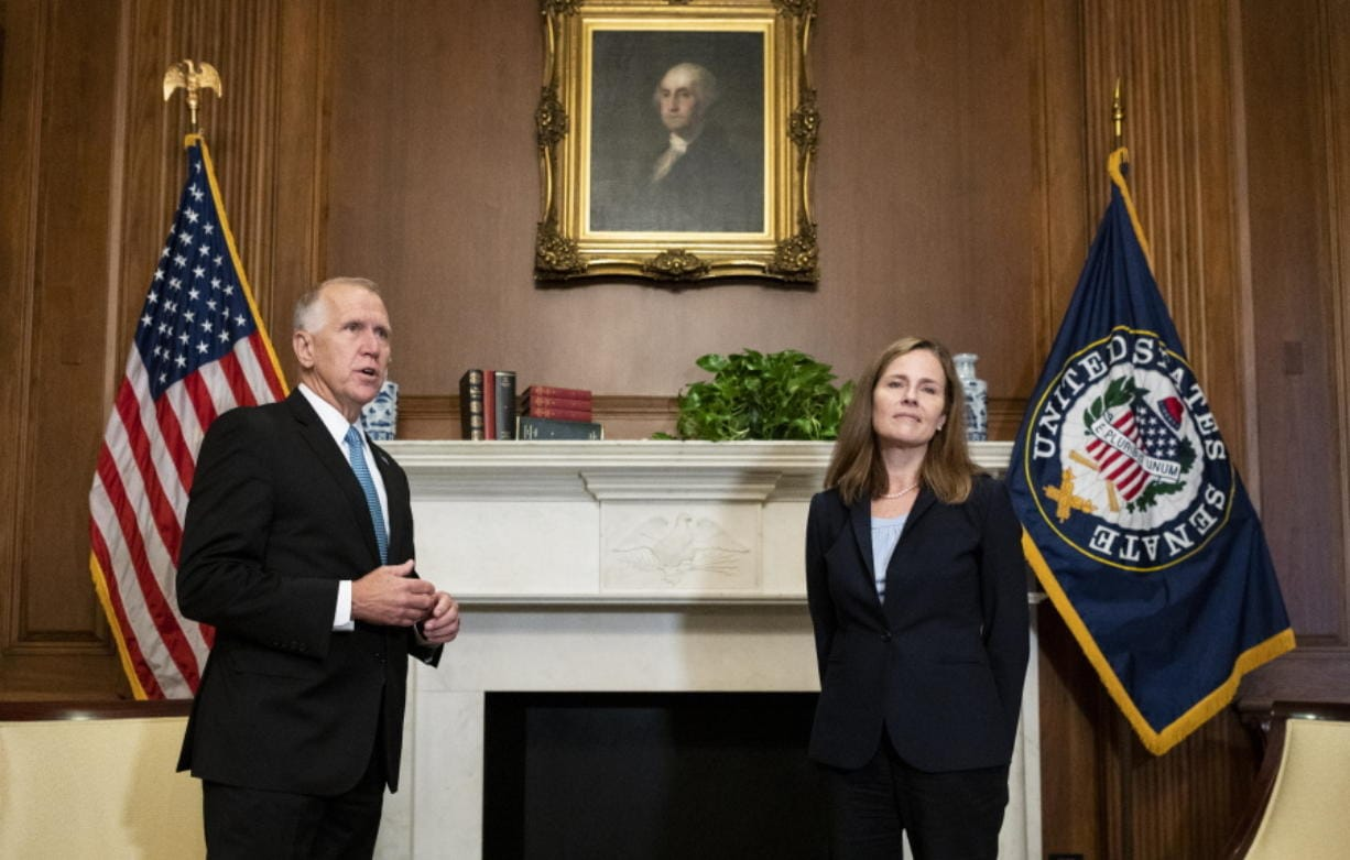 Sen. Thom Tillis, R-N.C., meets with Judge Amy Coney Barrett, President Donald Trump's nominee to the Supreme Court at the U.S. Capitol Wednesday, Sept. 30, 2020, in Washington.