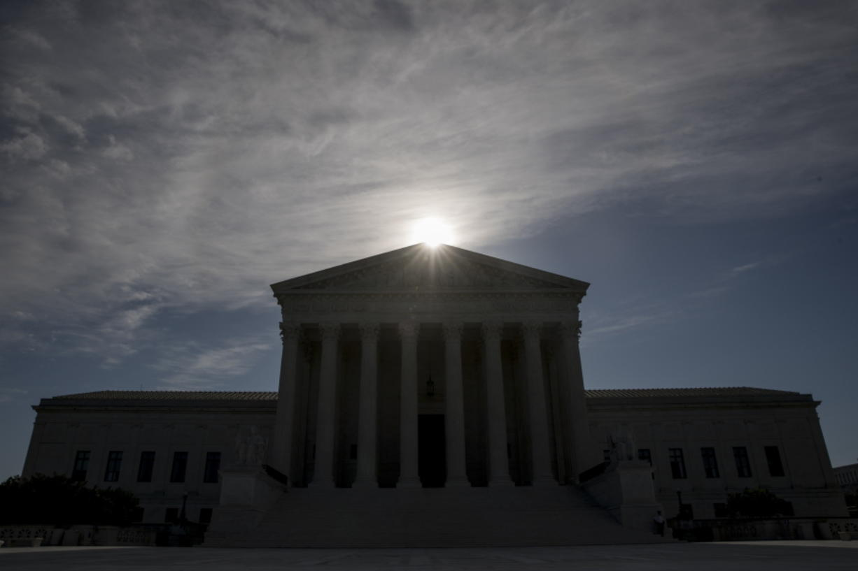 FILE - This May 4, 2020, file photo shows the Supreme Court building in Washington. Controversial Trump administration policies on the census, asylum seekers and the border wall, held illegal by lower courts, are on the Supreme Court's agenda Friday, Oct. 16, 2020.