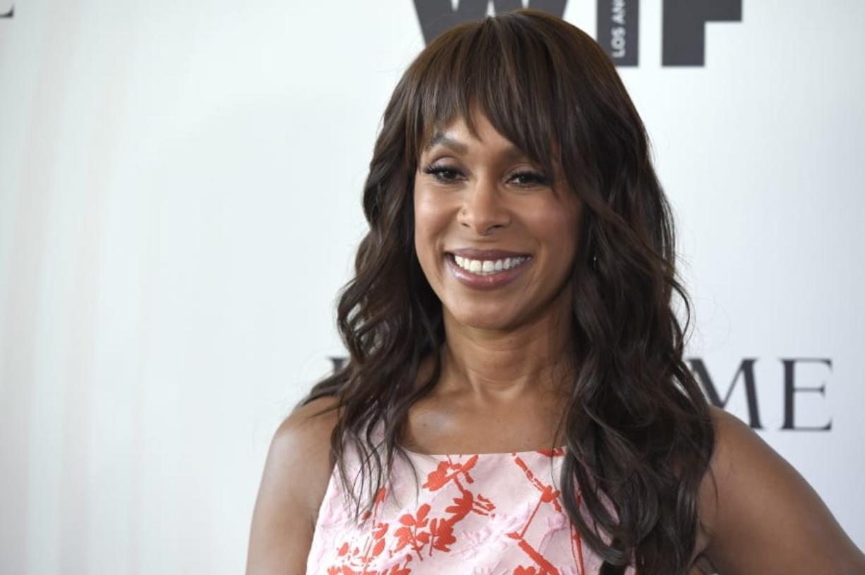 FILE - In this June 13, 2018 file photo, Channing Dungey arrives at the Women In Film Crystal and Lucy Awards in Beverly Hills, Calif.  Dungey has been named chairman, Warner Bros. Television Group, starting her tenure at the studio early next year. The news was announced today by Ann Sarnoff, Chair and CEO, WarnerMedia Studios and Networks Group, to whom she will report.