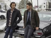 """This image released by The CW shows Jared Padalecki, left, and Jensen Ackles from the series """"Supernatural,"""" airing Oct. 8."""