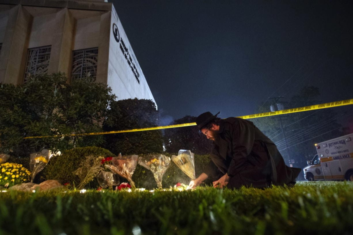 Rabbi Eli Wilansky lights a candle after a mass shooting at Tree of Life Synagogue in Pittsburgh's Squirrel Hill neighborhood on Oct. 27, 2018.