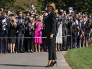 First lady Melania Trump pauses as she and President Donald Trump walk to board Marine One at the White House, Tuesday, Sept. 29, 2020, in Washington, for the short trip to Andrews Air Force Base en route to Cleveland for first debate against Democrat Joe Biden.