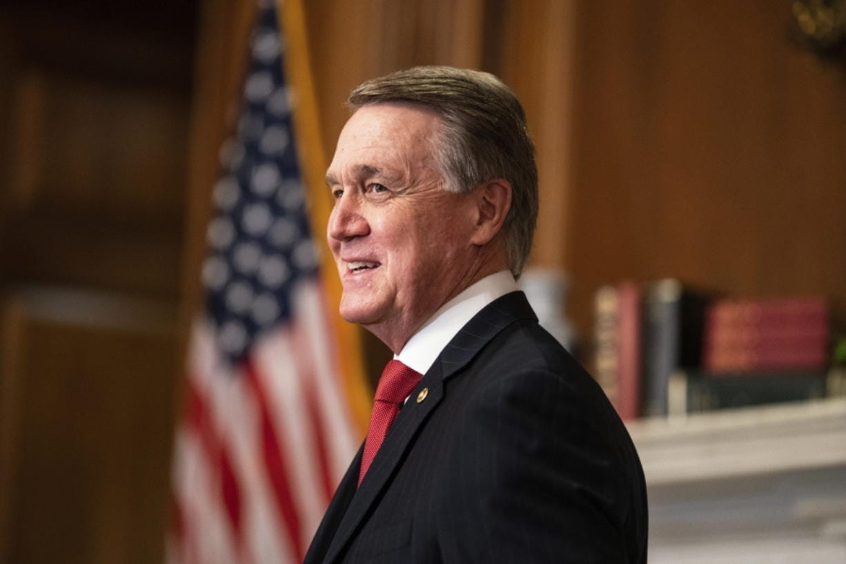 Sen. David Perdue, R-Ga., meets with Judge Amy Coney Barrett, President Donald Trumps nominee for the U.S. Supreme Court, not pictured, on Capitol Hill in Washington, Wednesday, Sept. 30, 2020.