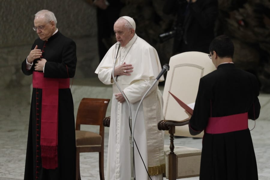 """Pope Francis, center, makes the sign of the cross during his weekly general audience in the Paul VI hall at the Vatican, Wednesday, Oct. 21, 2020. Pope Francis endorsed same-sex civil unions for the first time as pope while being interviewed for the feature-length documentary """"Francesco,"""" which premiered Wednesday at the Rome Film Festival."""