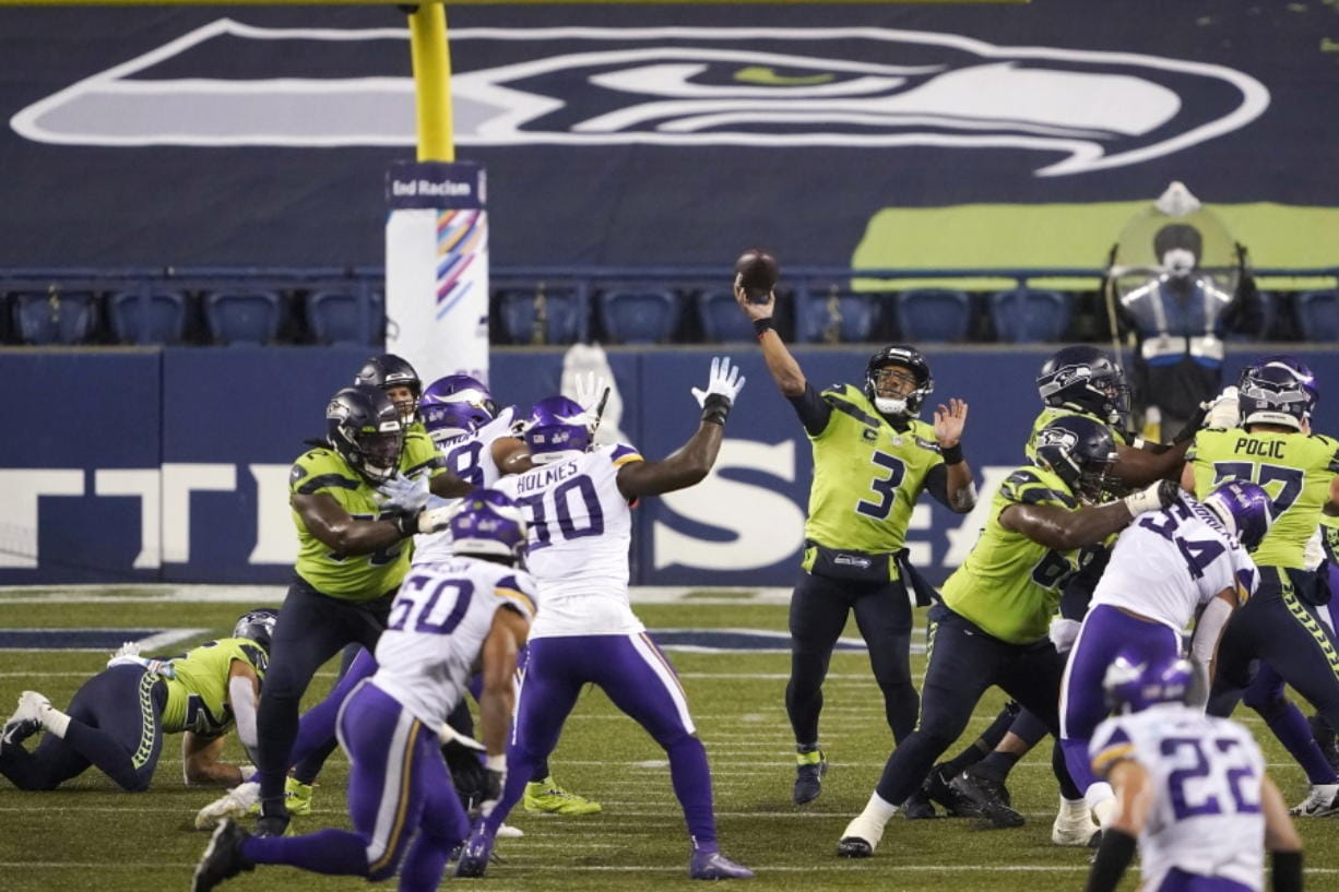 Seattle Seahawks quarterback Russell Wilson passes against the Minnesota Vikings late in the second half of an NFL football game, Sunday, Oct. 11, 2020, in Seattle. (AP Photo/Ted S.