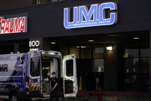 An ambulance is parked at the University Medical Center in Las Vegas on Oct. 12, 2020. Spikes of the coronavirus are hitting spots around the United States, forcing public health officials to scramble to ensure there are enough hospital beds to accommodate the sick.