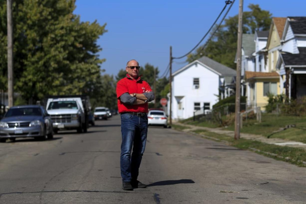 Gary Zaremba stands for a portrait outside of a house he oversees, Wednesday, Oct. 7, 2020, in Dayton, Ohio. Seven months after the pandemic began, landlords face an even more uncertain future. Zaremba, who owns and and manages 350 apartment units spread out over 100 buildings in Dayton, Ohio, said he has been working with struggling tenants and directs them to social service agencies for additional help.