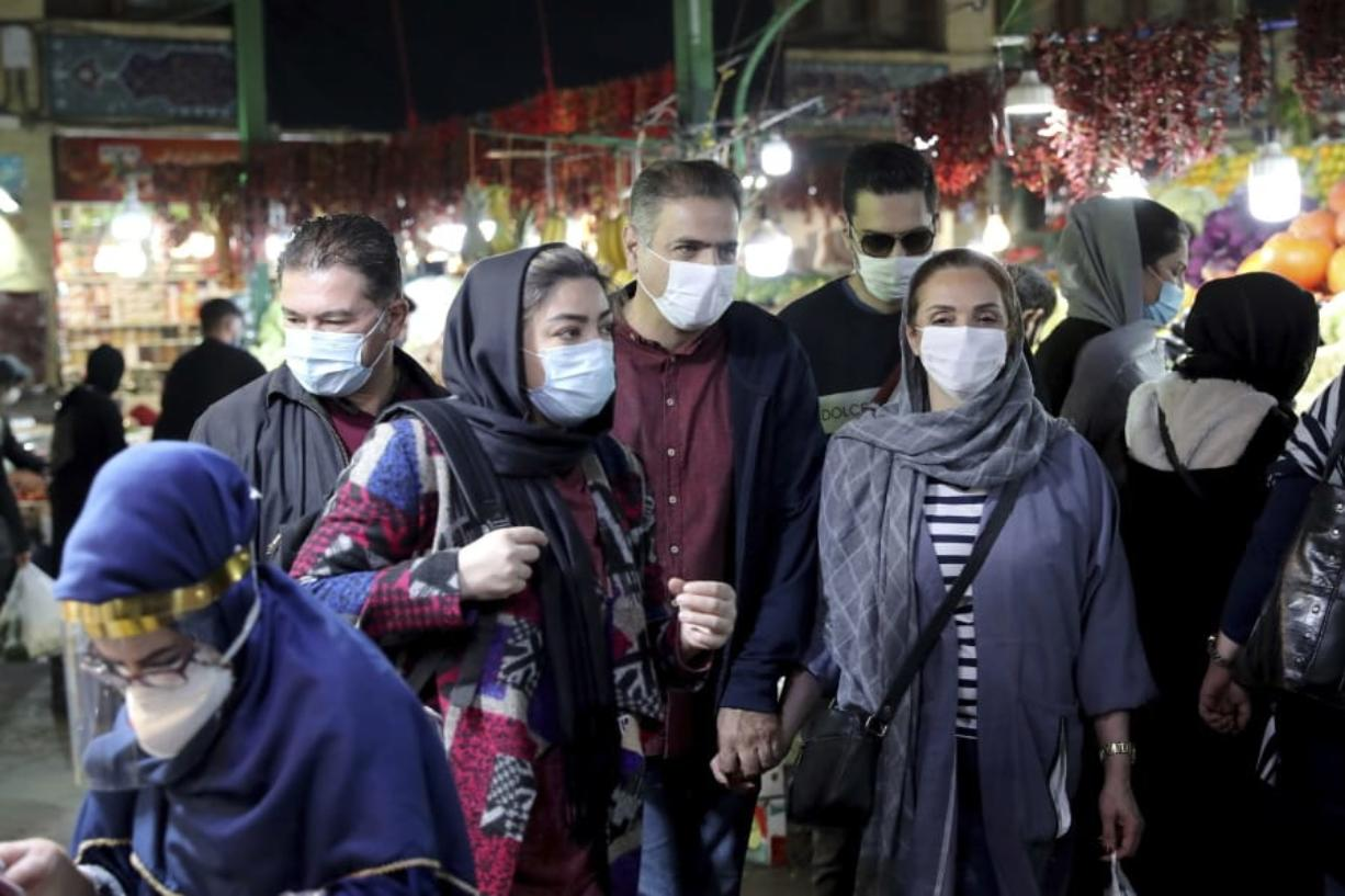 In this Oct. 15, 2020 file photo, people wear protective face masks to help prevent the spread of the coronavirus, in the Tajrish traditional bazaar in northern Tehran, Iran. On Monday, Oct.19, 2020, Iran recorded its worst day of new deaths since the start of the coronavirus pandemic, with 337 confirmed dead.
