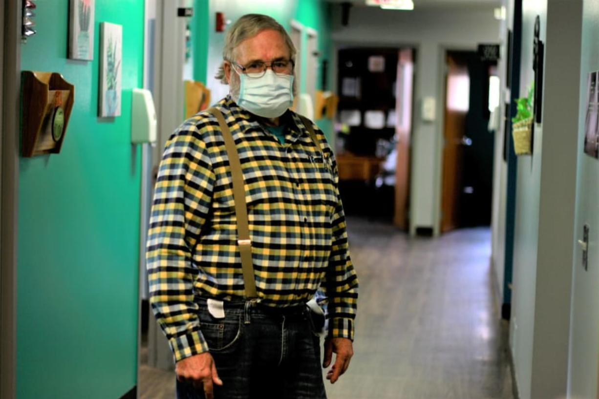 Dr. Tom Dean stands in his clinic Friday in Wessington Springs, S.D. He is one of three doctors in the county, which has seen a surge in virus cases.
