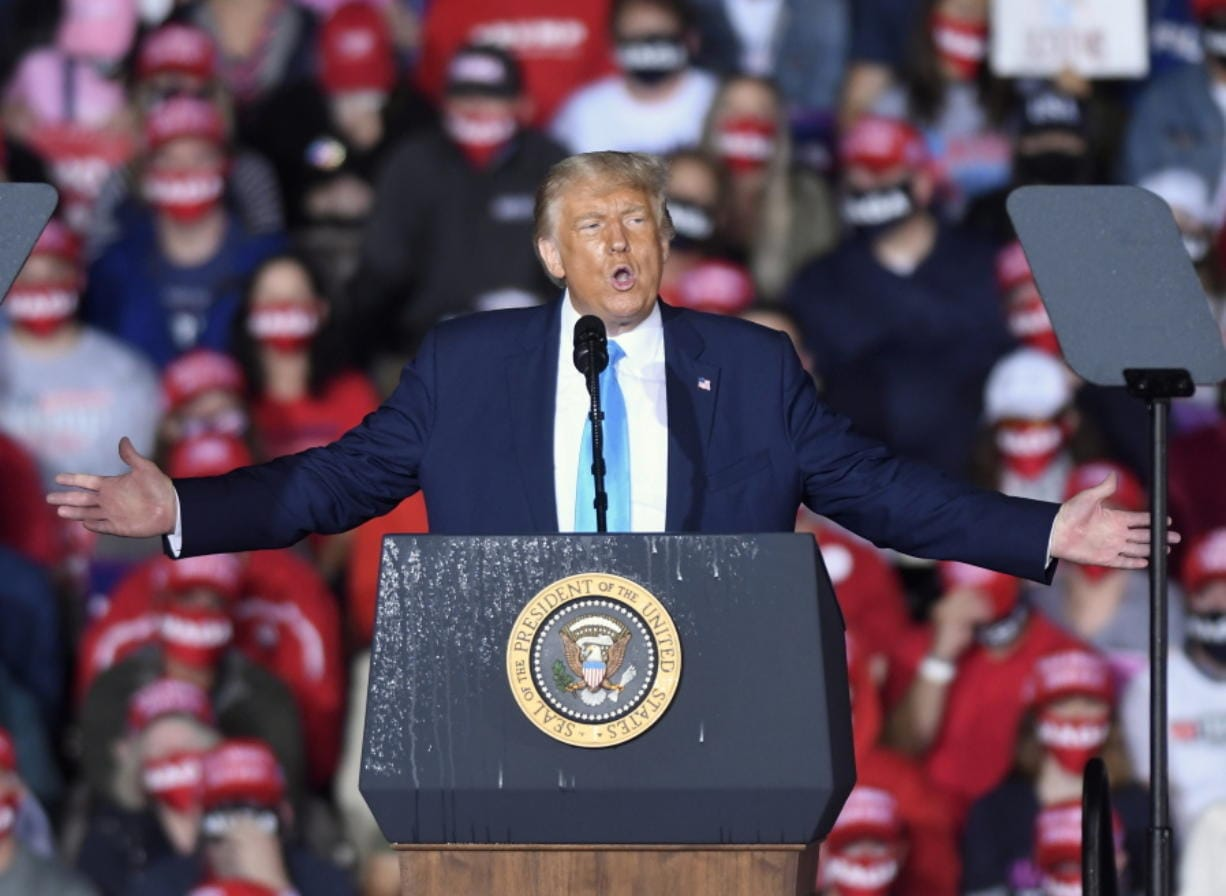 In this Sept. 26, 2020, file photo, President Donald Trump speaks during a campaign rally at Harrisburg International Airport in Middletown, Pa. President Trump and first lady Melania Trump have tested positive for the coronavirus, the president tweeted early Friday.