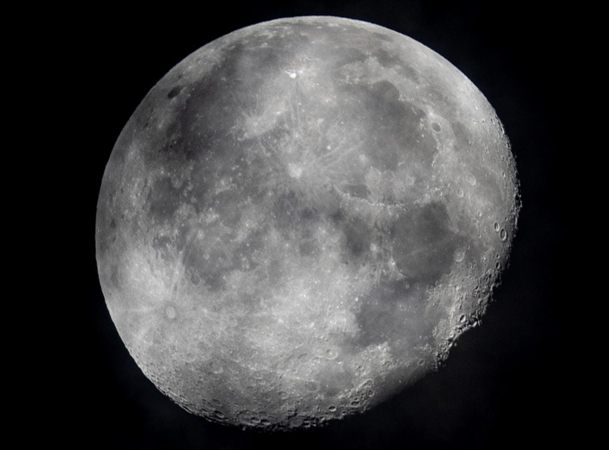 FILE - In this early Monday, Oct. 5, 2020, file photo, a waning moon is seen at the sky over Frankfurt, Germany. The moon's shadowed, frigid nooks and crannies may hold frozen water in more places and in larger quantities than previously suspected, good news for astronauts at future lunar bases who could tap into these resources for drinking and making rocket fuel, scientists reported Monday, Oct. 26, 2020.