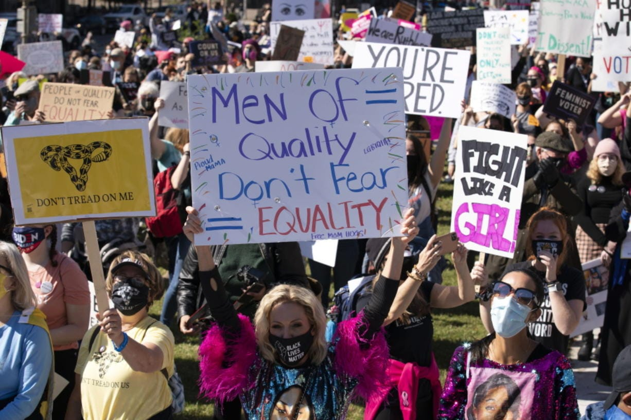 Protestors rally during the Women's March at Freedom Plaza, Saturday, Oct. 17, 2020, in Washington.
