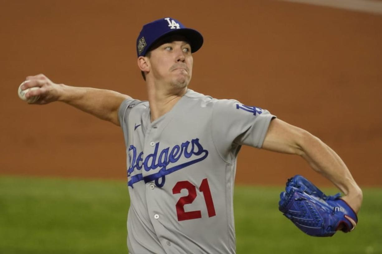 Los Angeles Dodgers starting pitcher Walker Buehler throws against the Tampa Bay Rays during the first inning in Game 3 of the baseball World Series Friday, Oct. 23, 2020, in Arlington, Texas.