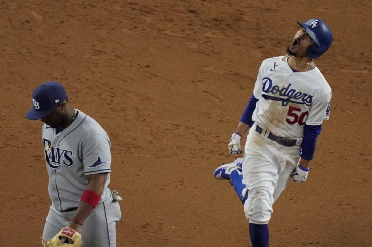 Los Angeles Dodgers' Mookie Betts celebrates after a home run against the Tampa Bay Rays during the eighth inning in Game 6 of the baseball World Series Tuesday, Oct. 27, 2020, in Arlington, Texas.