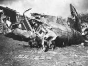 Dean Tate's B-17 crash landed on a hill above Monchy-Humieres, France. Tate and two crew mates bailed out.