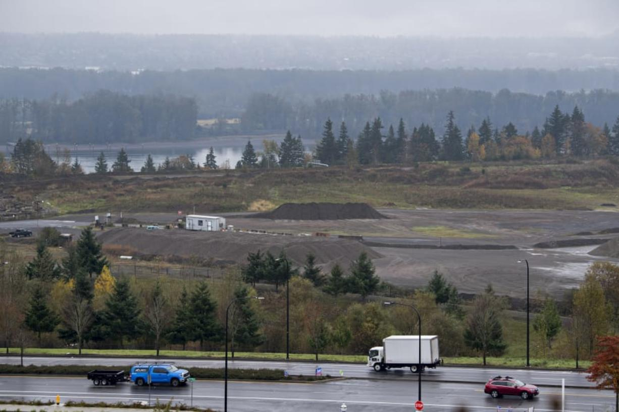 Motorists drive along Southeast 192nd Avenue through the old Fisher Quarry, where Hurley Development has plans to redevelop the west half. The east half is already under redevelopment.