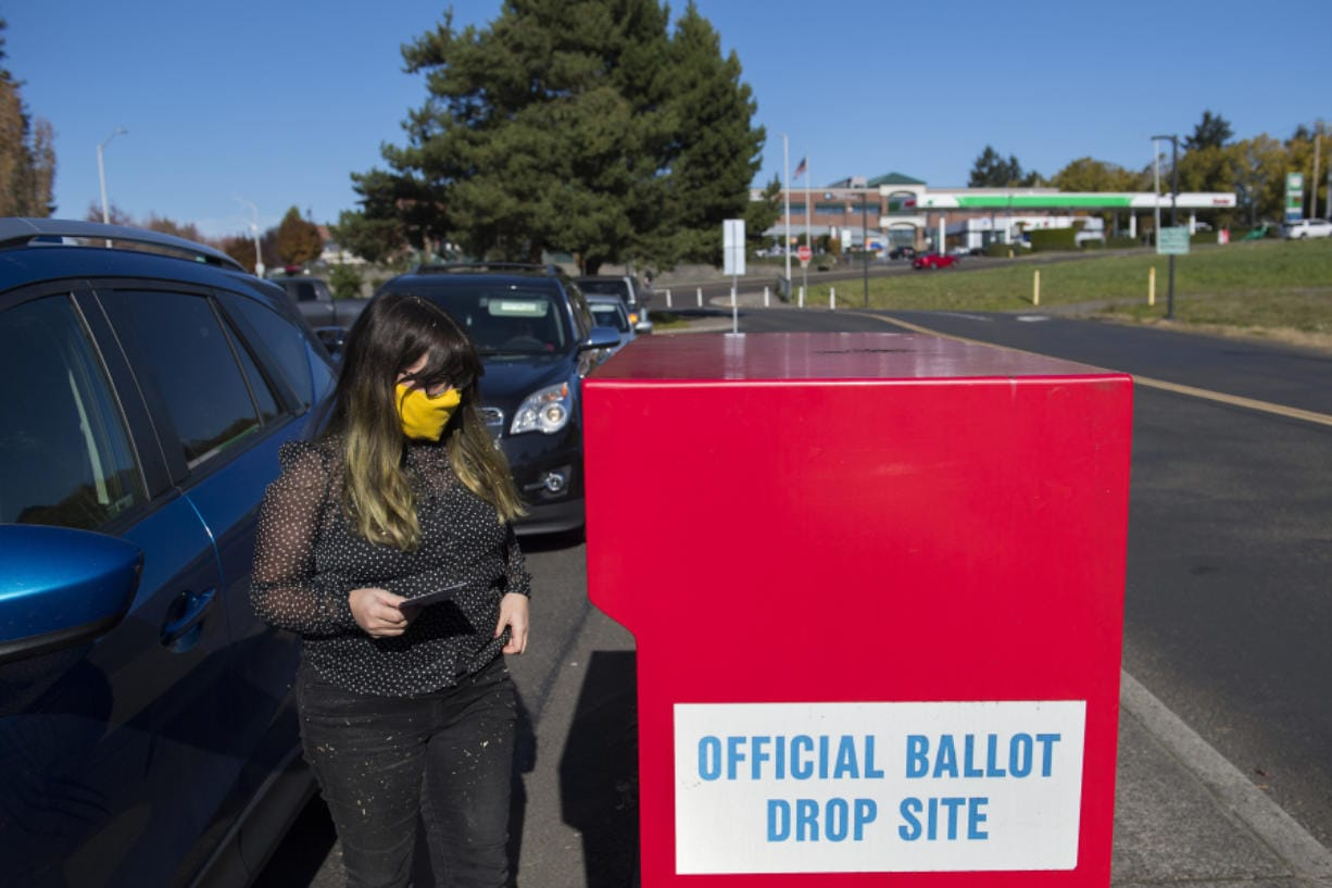 Voter Chelsea Unger joins a steady stream of local residents as they drop their ballots off in Fisher's Landing in time for this year's election.