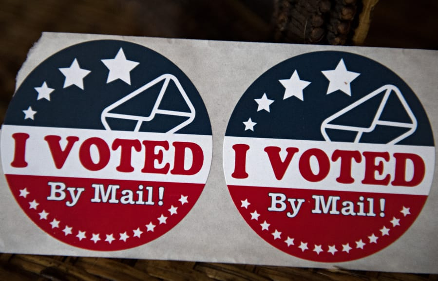 Vote By Mail stickers are pictured in Vancouver.