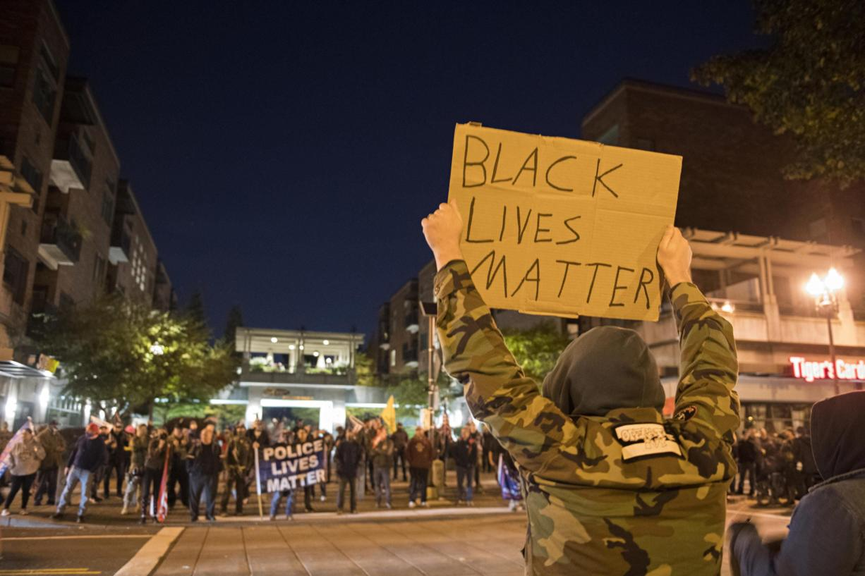 Black Lives Matter protesters face off against Blue Lives Matter and Patriot Prayer supporters in downtown Vancouver near Esther Short Park on Saturday night, Oct. 31, 2020.