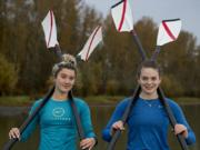 Rowers Kate Feustel, left, and Lauren Coop pause for a portrait at Vancouver Lake on Tuesday morning, Nov. 10, 2020.