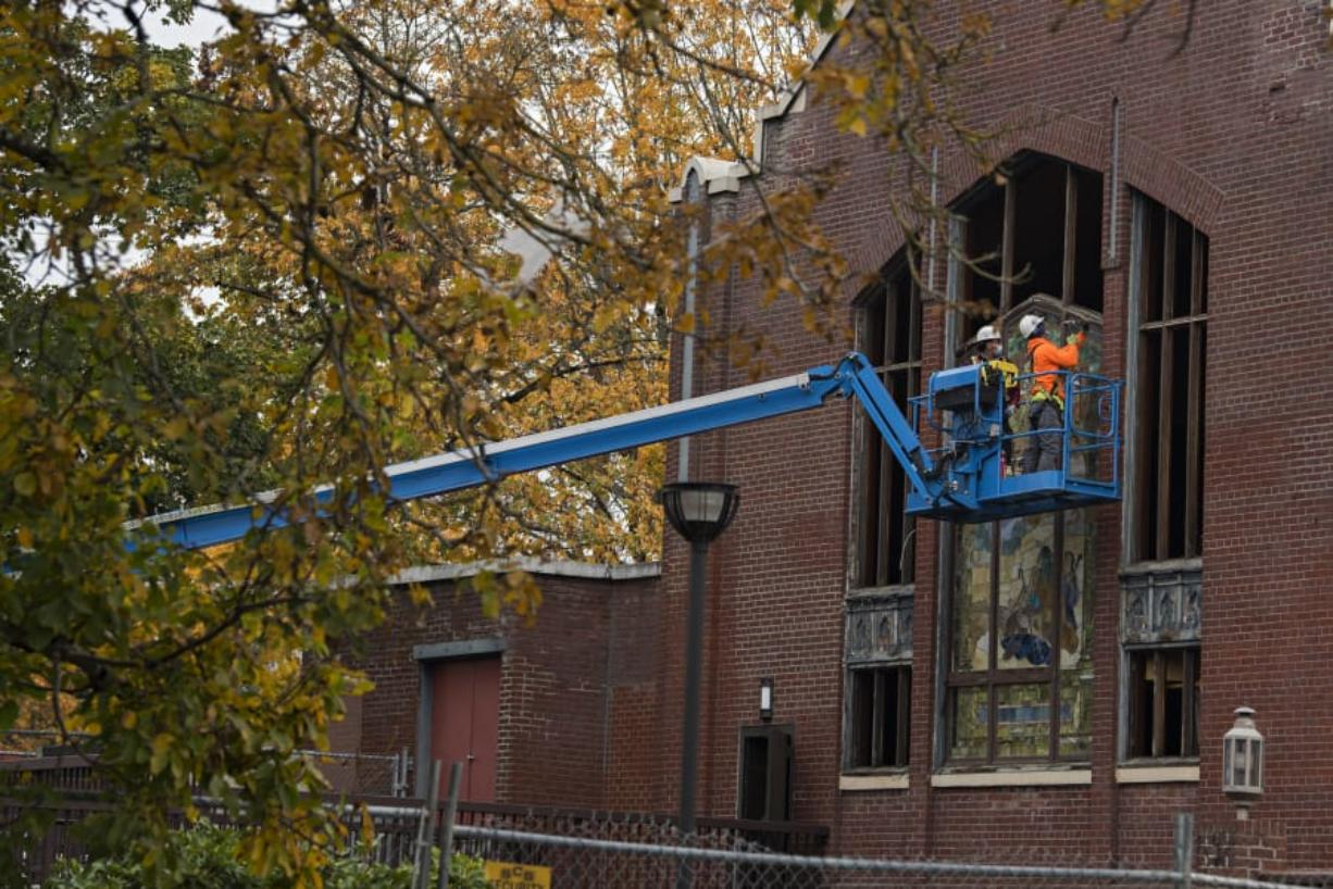 Crews gear up for demolition Monday morning at the former New Heights Church in downtown Vancouver. Much of the 108-year-old church's building materials will be salvaged and repurposed.