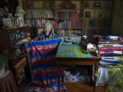 Nina Borroz, 98, has sewn about 150 to 200 quilts a year to donate to veterans organizations. Many have patriotic themes like this one she displays in the sewing room in her Minnehaha home on a recent morning.