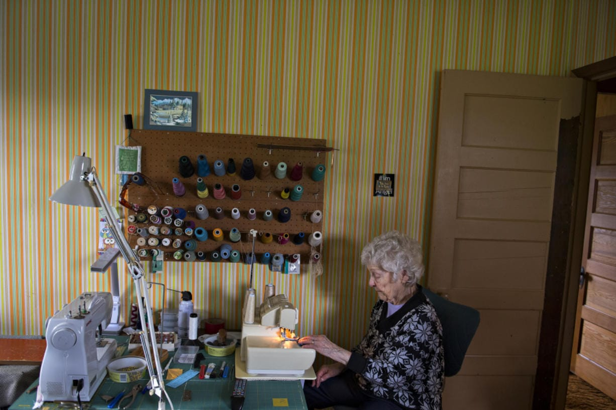 Nina Borroz, 98, has a stack of 40 quilts awaiting donation to veterans groups in the sewing room of her Minnehaha home.
